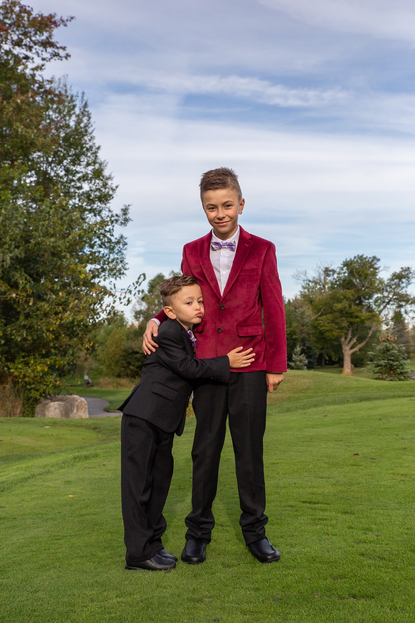two brothers dressed up on golf course