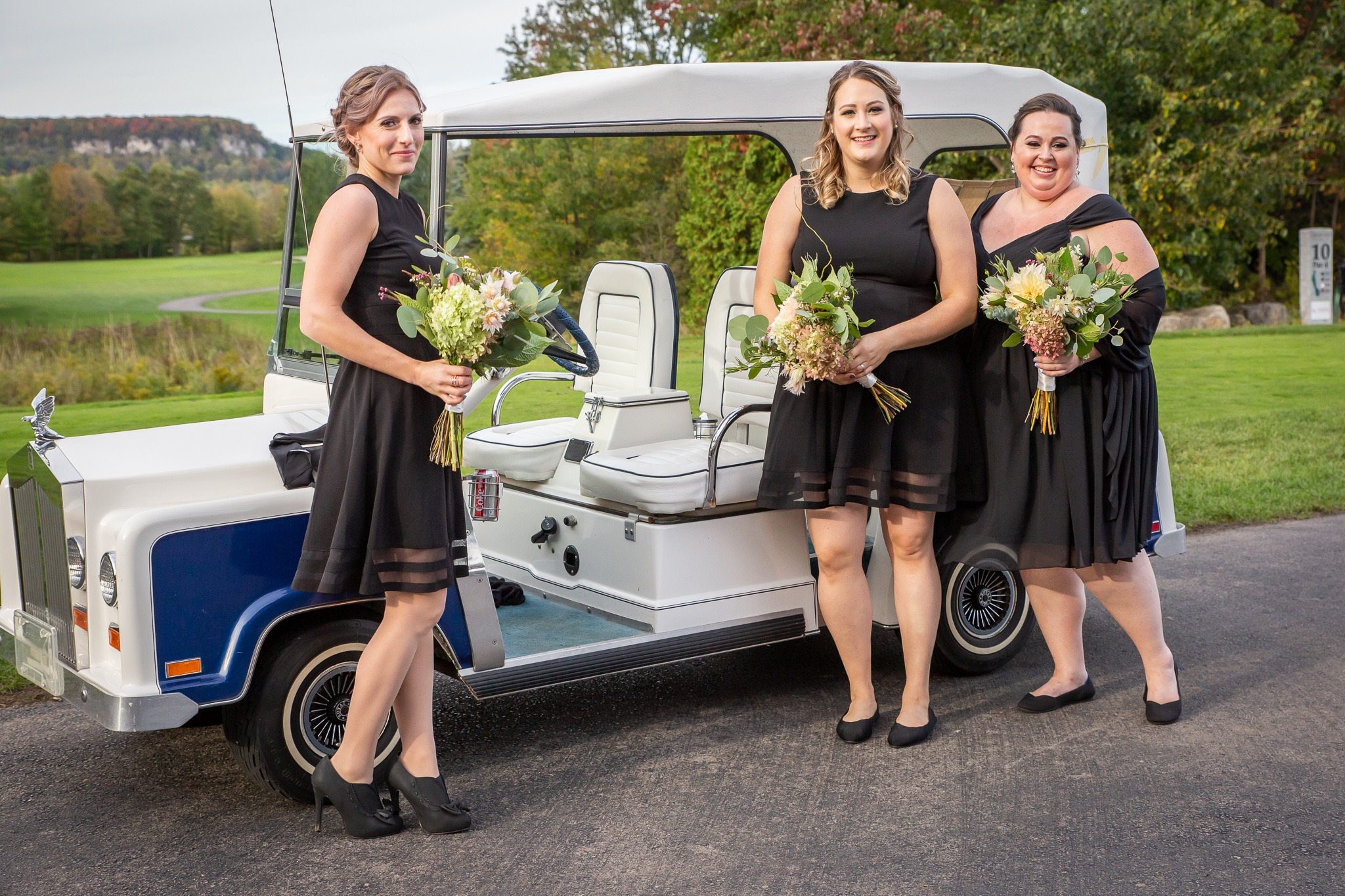 bridesmaids in black dresses on golf course