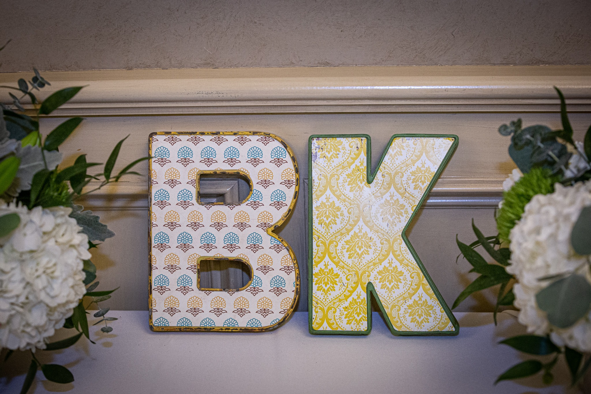 wooden letters B and K