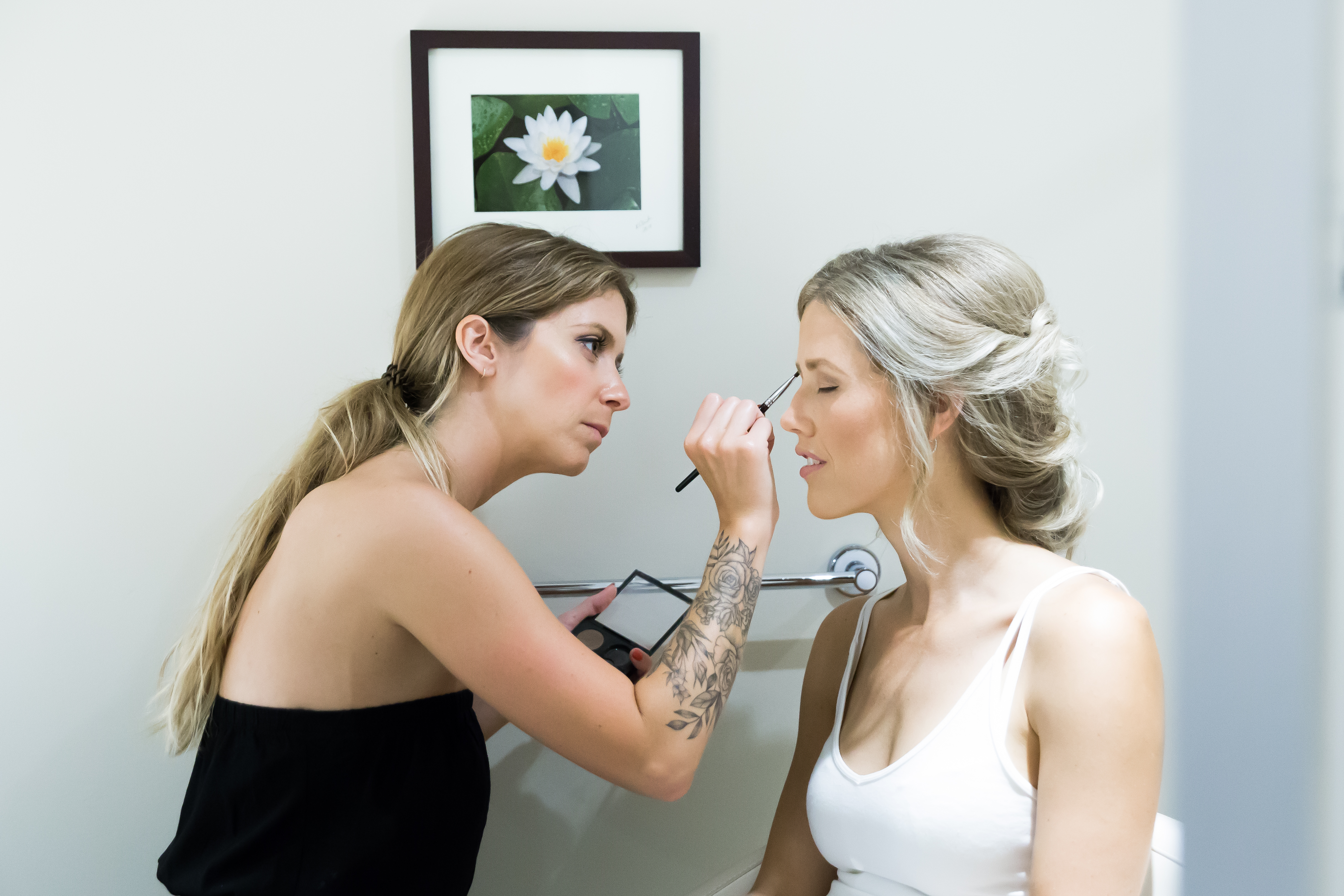 make up artist with the bride