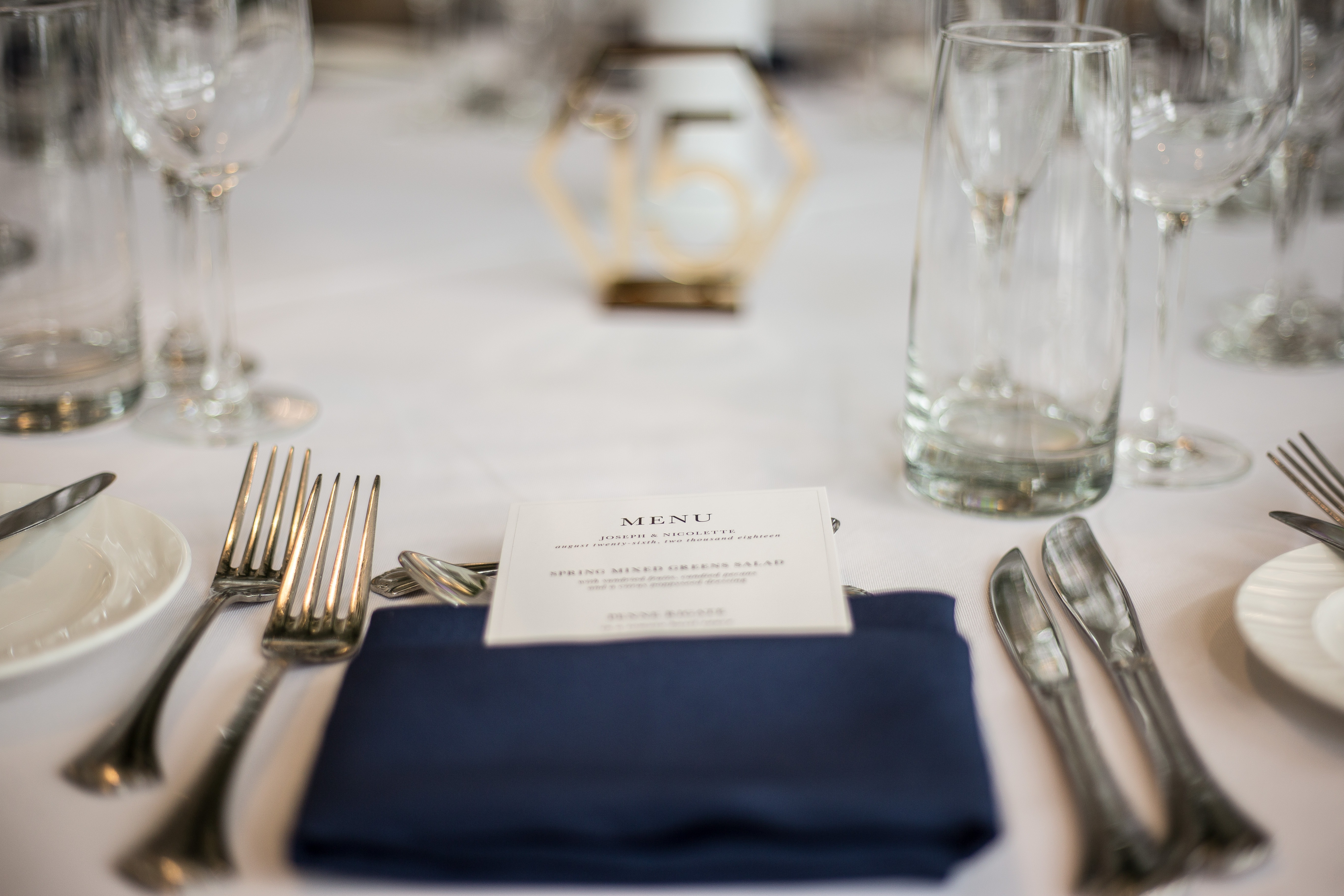 formal table setting with menu
