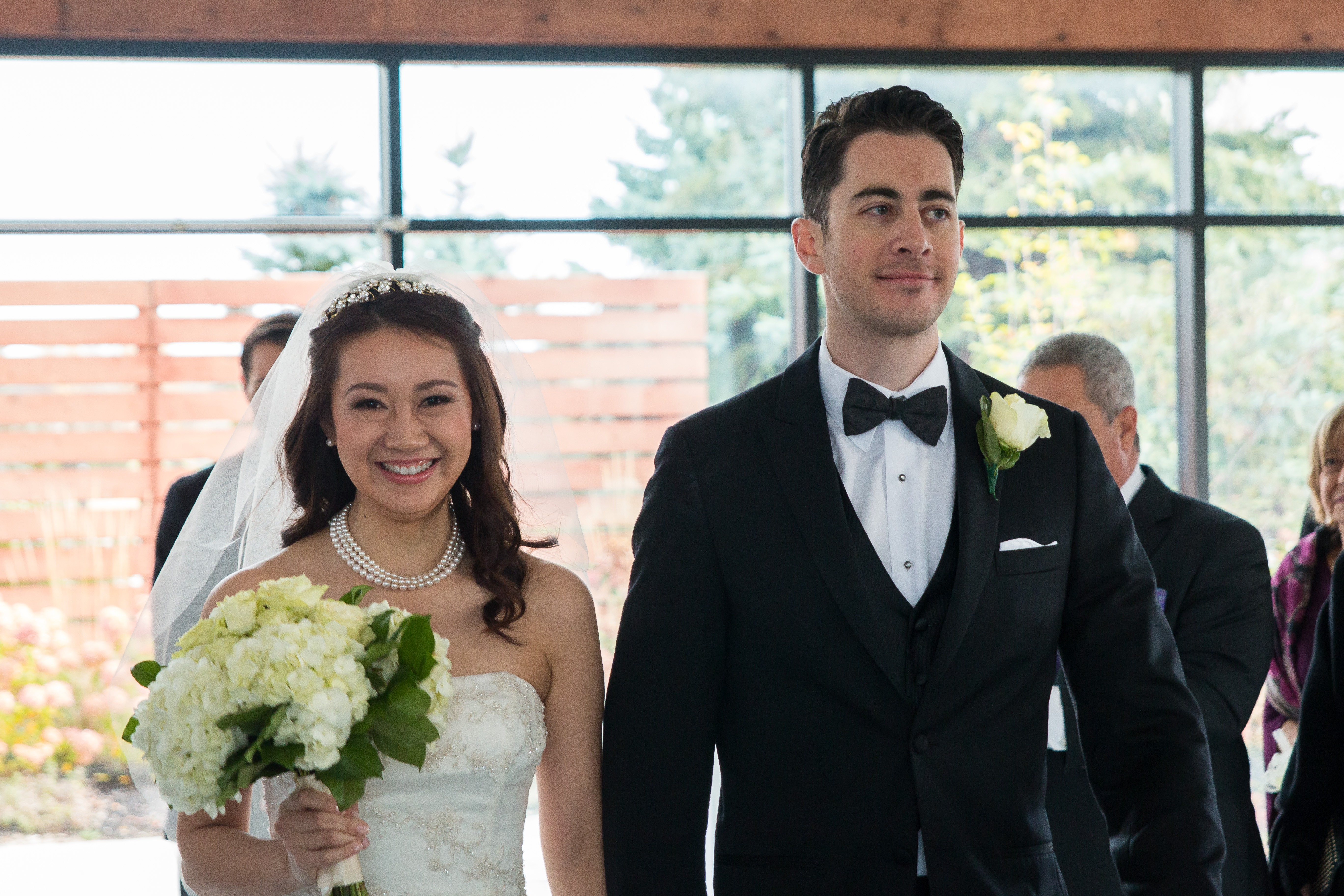 just married walking down the aisle smiling